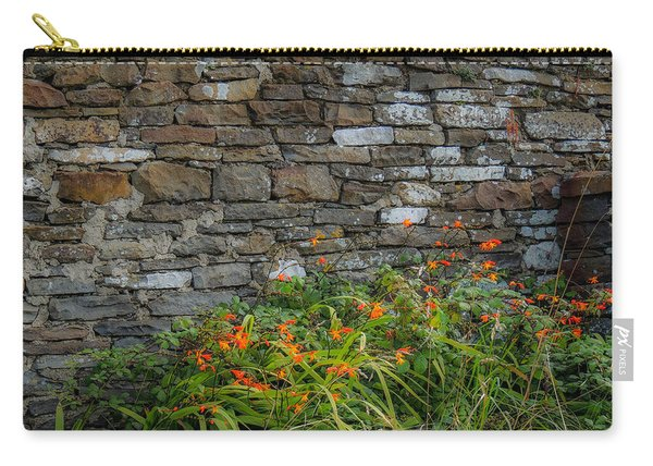 Orange Wildflowers Against Stone Wall Carry-all Pouch