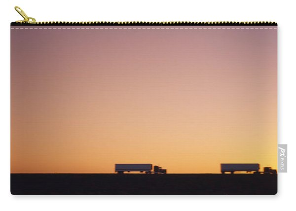 Silhouette Of Two Trucks Moving Carry-all Pouch