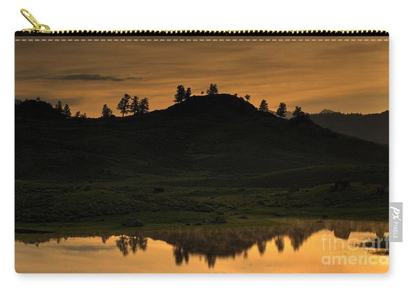 Carry-all Pouch featuring the photograph Sunrise Behind A Yellowstone Ridge by Bill Gabbert