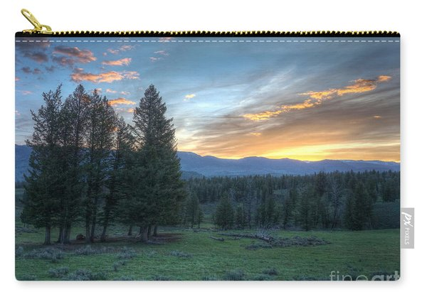 Carry-all Pouch featuring the photograph Sunrise Behind Pine Trees In Yellowstone by Bill Gabbert