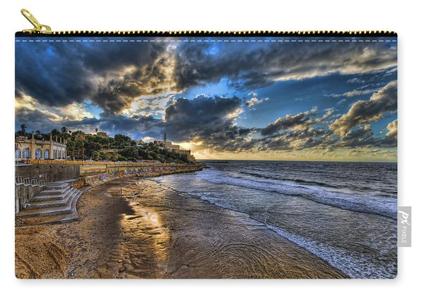 the golden hour during sunset at Israel Carry-all Pouch