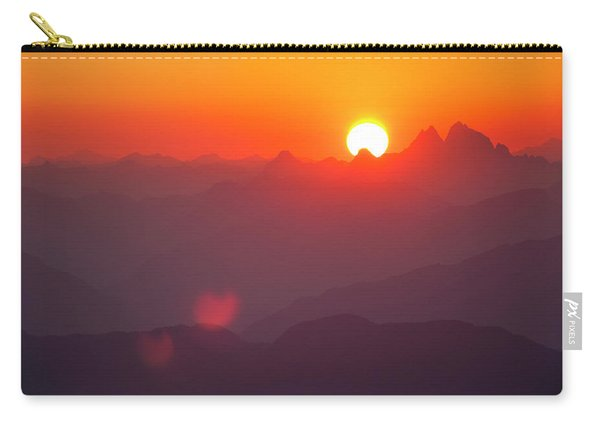 The Sun Sets Behind The Coast Mountain Carry-all Pouch