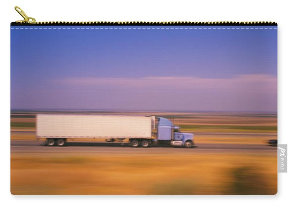 Truck And A Car Moving On A Highway Carry-all Pouch