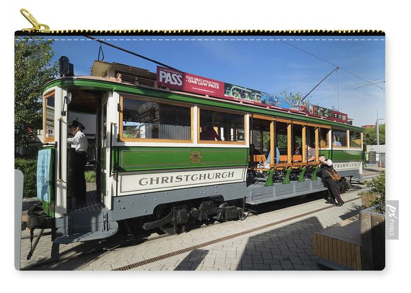 View Of Tram On Street In A City Carry-all Pouch
