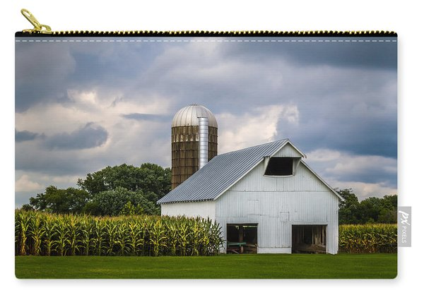 White Barn And Silo With Storm Clouds Carry-all Pouch