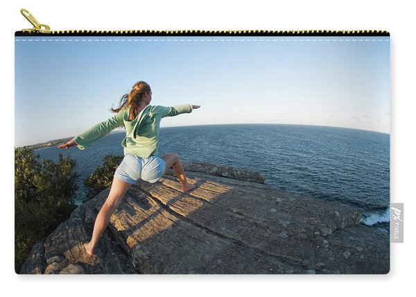 Yoga On Rocky Outcrop Above Ocean Carry-all Pouch