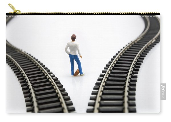 Figurine Between Two Tracks Leading Into Different Directions Symbolic Image For Making Decisions. Carry-all Pouch
