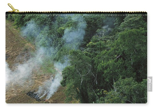 A Farmer Burns His Agricultural Field Carry-all Pouch