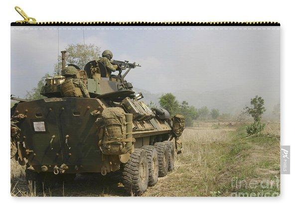 A U.s. Marine Uses An M-240b Machine Carry-all Pouch