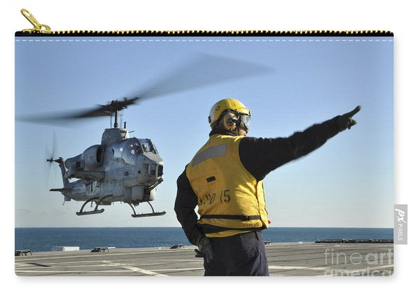 An Ah-1w Super Cobra Helicopter Lifts Carry-all Pouch