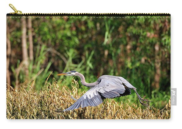 Heron Flying Along The River Bank Carry-all Pouch