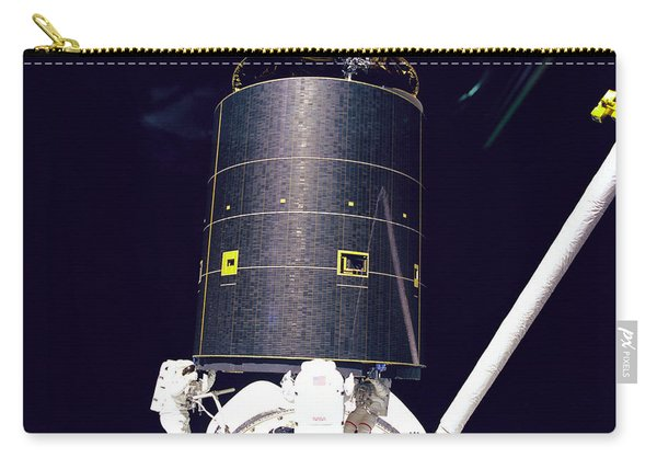 Three Crew Members Capture Intelsat Vi Carry-all Pouch