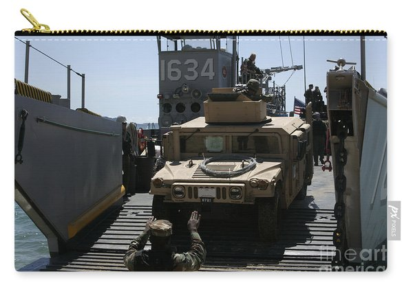 U.s. Marines Load An M1114 Humvee Onto Carry-all Pouch
