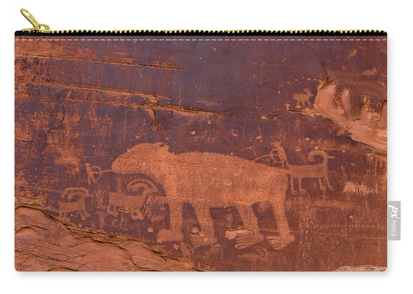 Carry-all Pouch featuring the photograph Ancient Native American Petroglyphs On A Canyon Wall Near Moab. by Jim Thompson