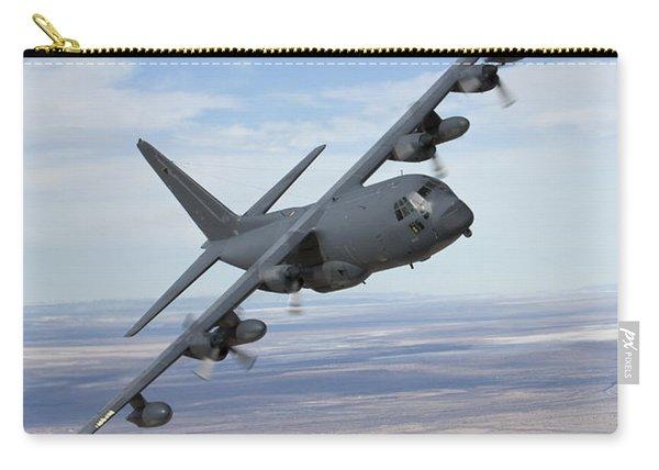 An Mc-130 Aircraft Manuevers Carry-all Pouch