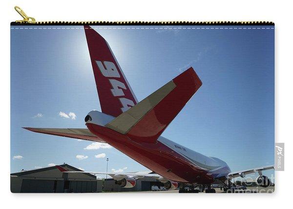Carry-all Pouch featuring the photograph 747 Supertanker At Mcclellan by Bill Gabbert