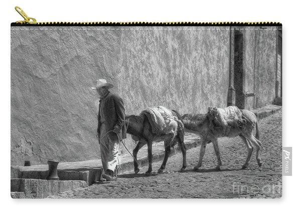 A Man With Two Burros Carry-all Pouch