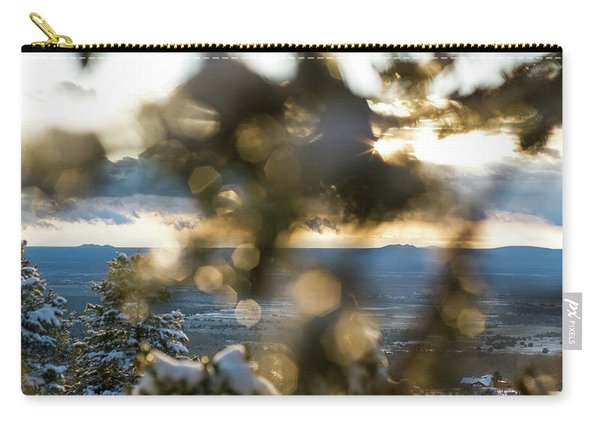 Carry-all Pouch featuring the photograph A Peek At Taos Mesa by Jason Coward