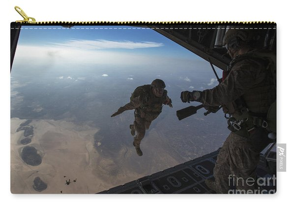 A U.s. Marines Jumps From A Hc-130 Carry-all Pouch