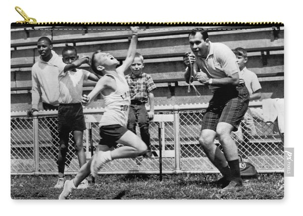 A Young Athlete Sprinting Carry-all Pouch