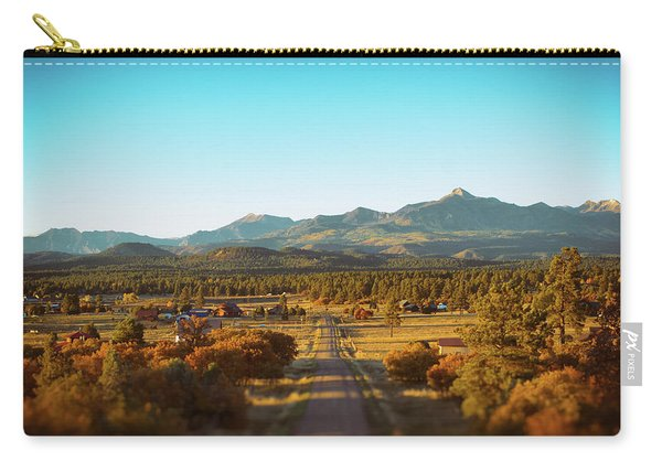 Carry-all Pouch featuring the photograph An Autumn Evening In Pagosa Meadows by Jason Coward