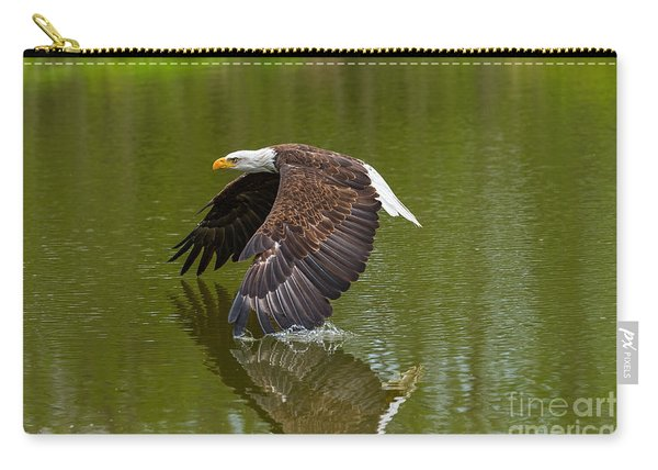 Bald Eagle In Low Flight Over A Lake Carry-all Pouch