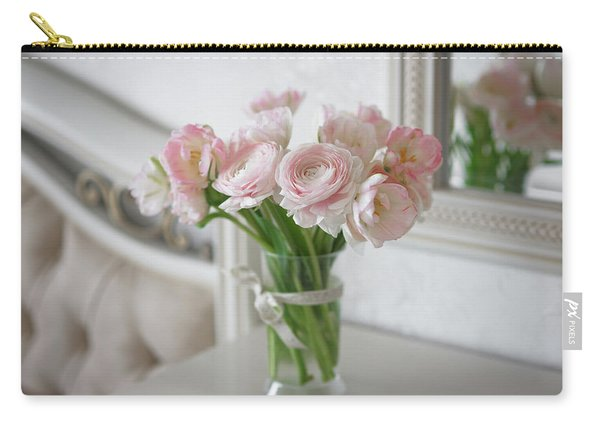 Carry-all Pouch featuring the photograph Bouquet Of Delicate Ranunculus And Tulips In Interior by Sergey Taran