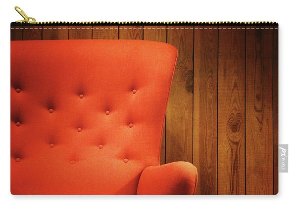Classic Red Armchair Near A Wooden Wall Carry-all Pouch