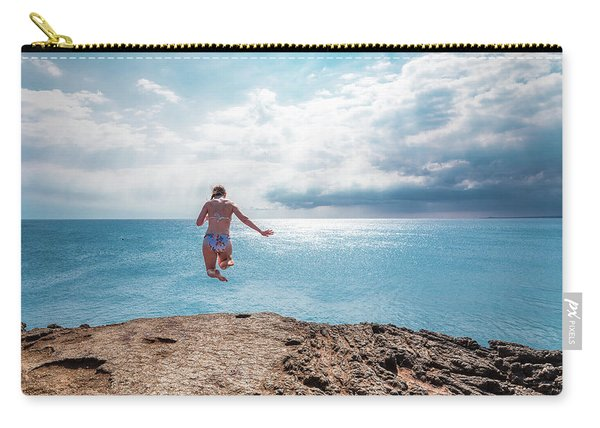 Carry-all Pouch featuring the photograph Cliff Jumping by Break The Silhouette