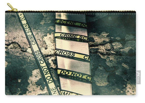 Closeup Of Knife Wrapped With Do Not Cross Tape On Floor Carry-all Pouch