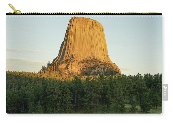 Carry-all Pouch featuring the photograph Devils Tower At Sunset by Bill Gabbert