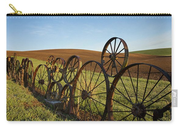 Carry-all Pouch featuring the photograph Fence Of Wheels by Mary Lee Dereske