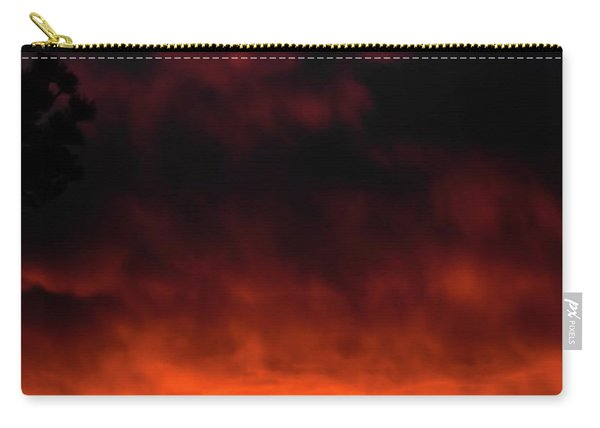 Carry-all Pouch featuring the photograph Fiery Sky by Jason Coward