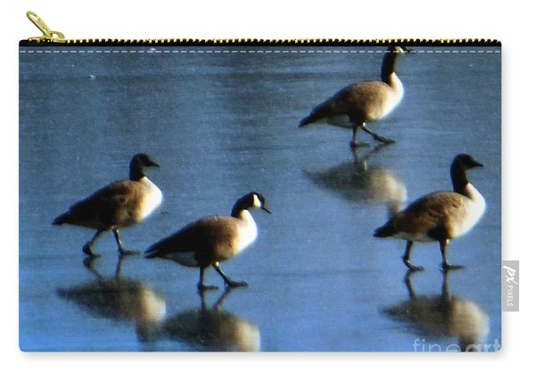 Four Geese Walking On Ice Carry-all Pouch
