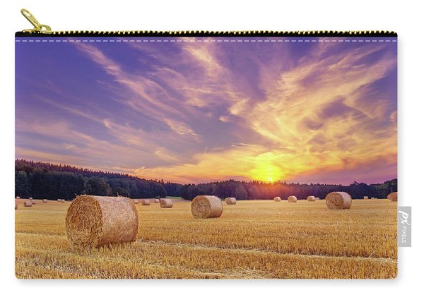 Carry-all Pouch featuring the photograph Hay Bales And The Setting Sun by Dmytro Korol