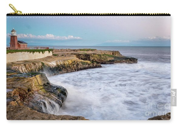 Long Exposure Of Waves Against The Cliff With Lighthouse In Shot Carry-all Pouch