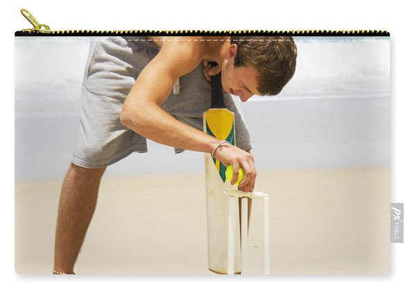 Man Playing Beach Cricket Carry-all Pouch