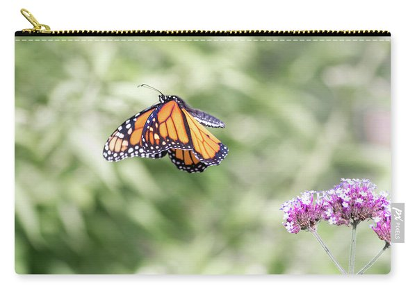 Carry-all Pouch featuring the photograph Mid-air Monarch 1 by Brian Hale