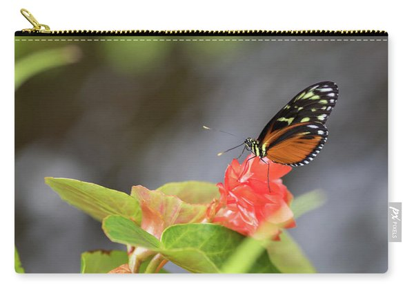 Carry-all Pouch featuring the photograph Orange And Black Butterfly by Raphael Lopez