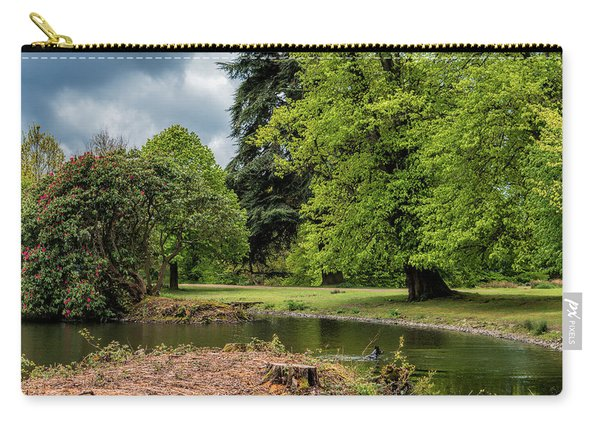 Carry-all Pouch featuring the photograph Petworth Lake With Dog by Michael Hope