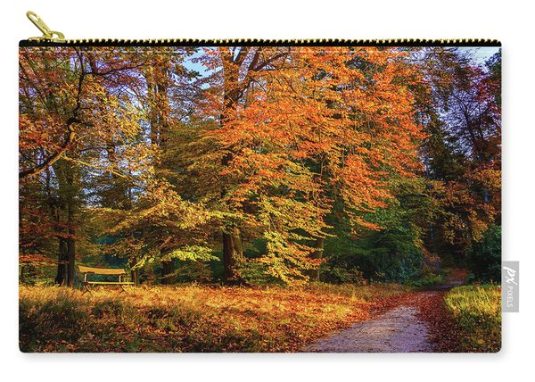 Carry-all Pouch featuring the photograph Resting Place In An Autumn Park by Dmytro Korol