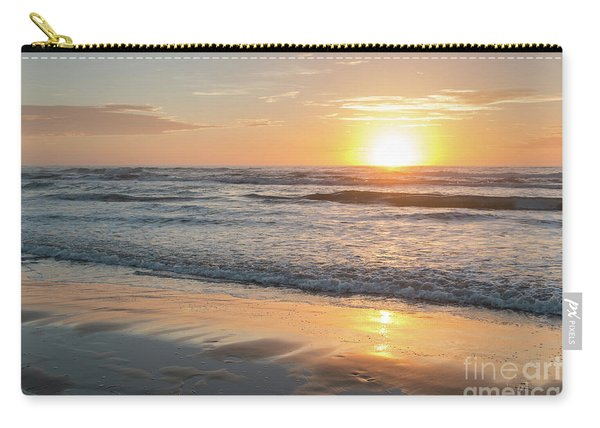 Rising Sun Reflecting On Wet Sand With Calm Ocean Waves In The B Carry-all Pouch
