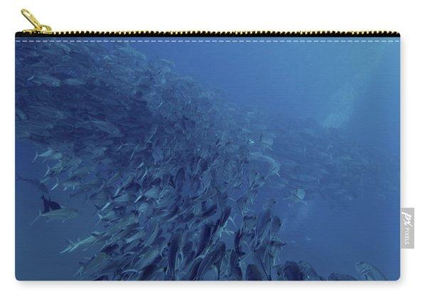 Scuba Diver Swimming Over A Massive Carry-all Pouch