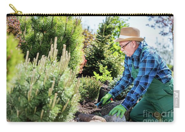 Senior Gardener Digging In A Garden. Carry-all Pouch