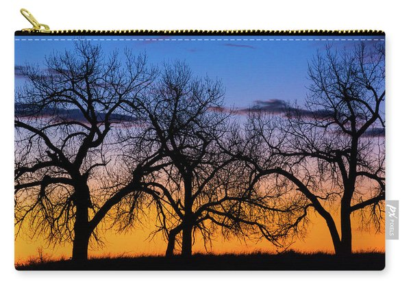 Carry-all Pouch featuring the photograph Silhouettes Of A Spring Sunrise by John De Bord