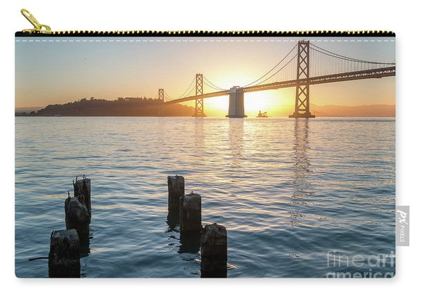 Six Pillars Sticking Out The Water With Bay Bridge In The Backgr Carry-all Pouch