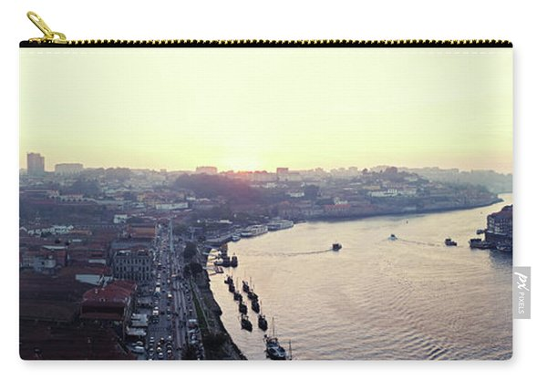 Carry-all Pouch featuring the photograph sunset panorama of the Douro river in Porto, Portugal by Ariadna De Raadt