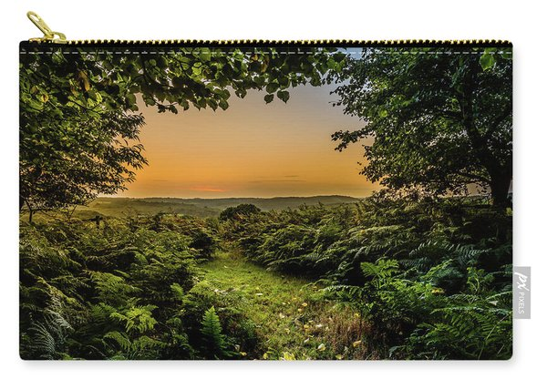 Carry-all Pouch featuring the photograph Sunset Through Trees by Nick Bywater