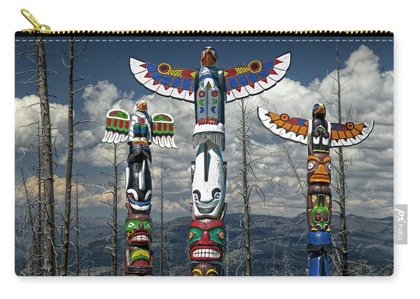 Three Totem Poles In The Northwest Carry-all Pouch