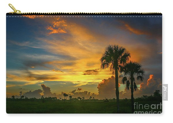 Carry-all Pouch featuring the photograph Two Palm Silhouette Sunrise by Tom Claud